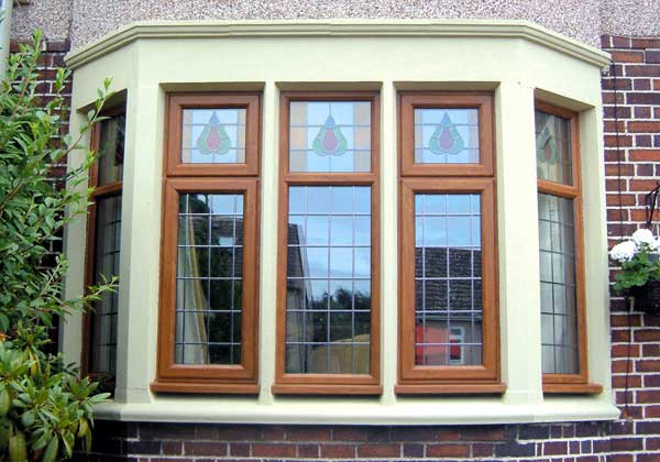 Double Glazing - Golden oak upvc bay window with traditional leaded lights