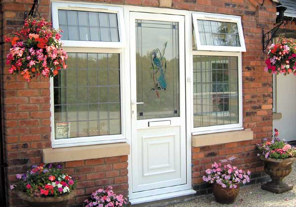 Double Glazing - Bespoke white upvc front door with decorative glass
