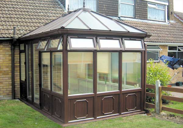 Rosewood conservatory with frames to floor level